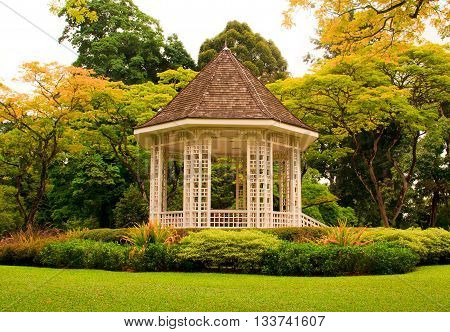 Wooden house gazebo in the colorful tropical garden