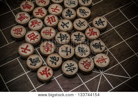 Chinese chesses on chessboard it is very commond in China and the are different characters written in chinese