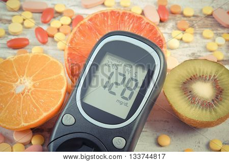 Vintage photo Glucose meter with result of measurement sugar level fresh natural fruits and medical pills tablets and supplements diabetes healthy lifestyle and nutrition