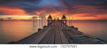 Landscape of Wooded bridge in the Thai temple and sunrise