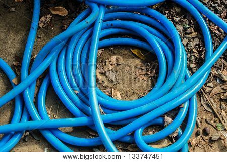 The blue water hose reels for clutter.