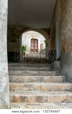 Stone Steps Leading Through A Covered Walkway