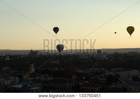Hot air balloons flying over a city extreme sport background