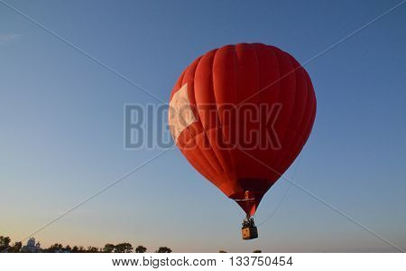 Hot air balloon red color balloon flying. Sport equipment