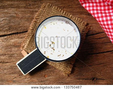 dust in milk glass and small wooden for text,dirty milk and unable drink