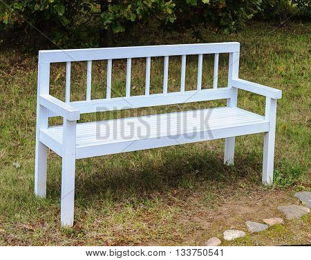 White wooden bench in old suburban autumn park