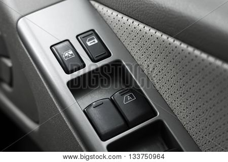 automatic window buttons in a car door panel