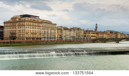 Florence - circa September of 2012, Tuscany region, Italy: Сityscape of Florence in cloudy winter day, view on river Arno