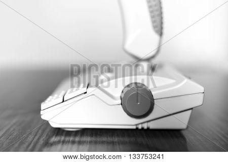 Black and white retro arcade joystick bokeh background