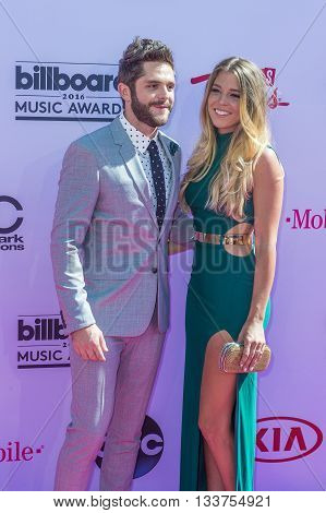 LAS VEGAS - MAY 22 : Singer Thomas Rhett (L) and Lauren Gregory Akins attend the 2016 Billboard Music Awards at T-Mobile Arena on May 22 2016 in Las Vegas Nevada.