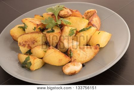 pottatto fry garnished with coriander in a plate