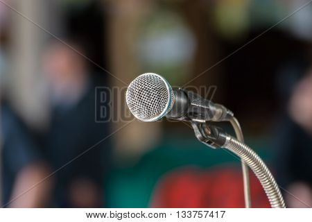 Microphone in seminar event defocus person background