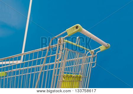 Minimalism Style, Shopping Cart And Blue Wall.
