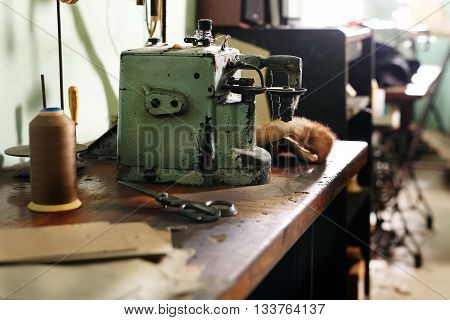 Sewing machine in a tailor shop .