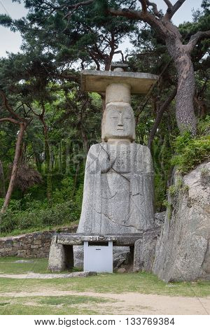 The ancient 10-metre-high standing stone of Buddha statue at Daejosa Temple in Buyeo city South Korea. The temple was built during the Goryeo dynasty (918-1392).