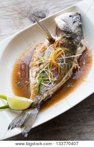 Grilled dorado fish with soy sauce and lime