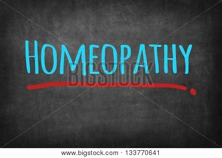 Homeopathy blue words - on blackboard background
