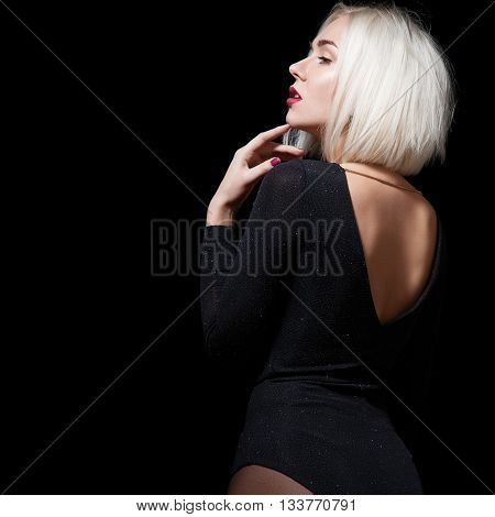 Woman Dancer With Short Blond Hair In Shiny Black Body On A Black Background