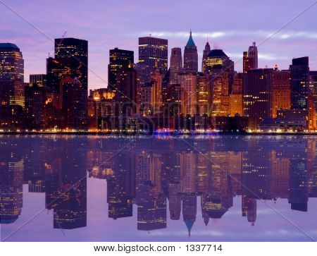 Early Morning Manhattan Skyline With Water Reflection