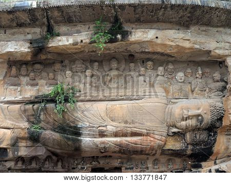 The 23 m Giant Reclining Buddha (Wofо) carved out of the 10 m cliff in the 10th century CE. The relief is located near Anyue Sichuan province China. It is included in the group of monuments «Anyue Rock Carvings».