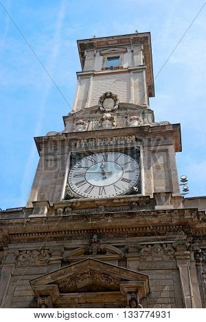 Milan Italiy. Giureconsulti palace decoration. Clock tower. Construction of the palace began in 1562 by the architect Vincenzo Seregni.