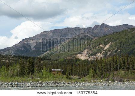 Mountains rise above Alaska's Nenana River near Denali National Park