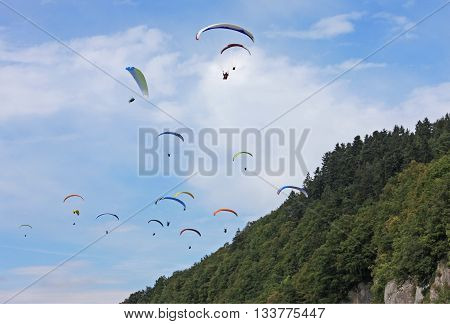 Paragliders flying high in the French Alps