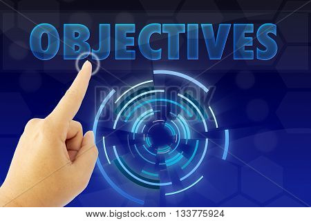 touching OBJECTIVES sign on blue digital screen