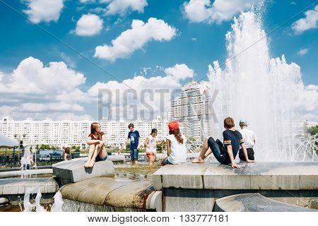 Minsk, Belarus - June 2, 2015: Young People Sit Resting Near Fountain In Summer Heat. Nemiga Ditrict In Minsk, Belarus
