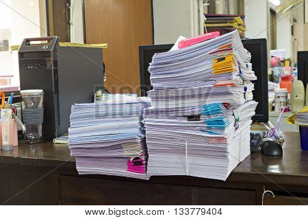 Stack Of Documents And Computer On The Office Desk
