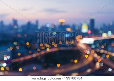 Blurred bokeh lights, interchanged road with CBD background