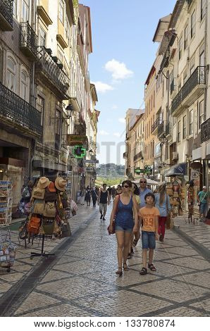 COIMBRA, PORTUGAL - AUGUST 3, 2016: People in a commercial street of the downtown of Coimbra Portugal