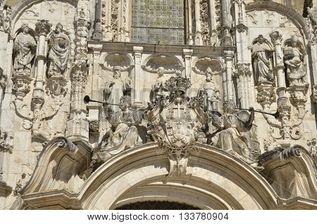 Detail of stone sculptures on facade of Monastery of the Holy Cross best known as Igreja Church in Coimbra Portugal.