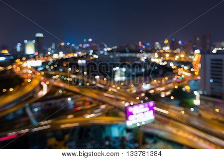 Blurred bokeh light night view city road overpass, abstract backgroundB