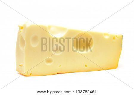 Sector part of yellow cheese. Close-up. Isolated on white