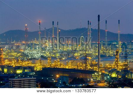 Petrol chemical plant lights night time with mountain background