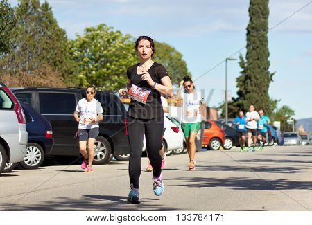 BADIA DEL VALLES BARCELONA SPAIN - APRIL 17 2016: Unidentified runners in the track during the event of