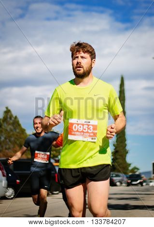 BADIA DEL VALLES BARCELONA SPAIN - APRIL 17 2016: Unidentified runner in the track during the event of