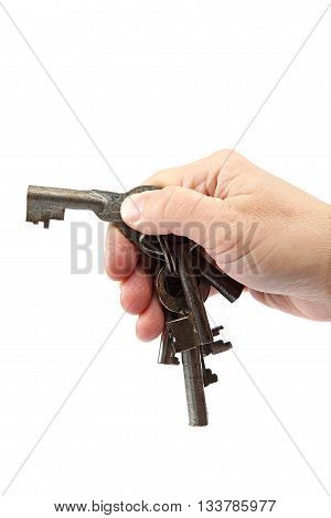 Old keys in hand isolated on a white background.