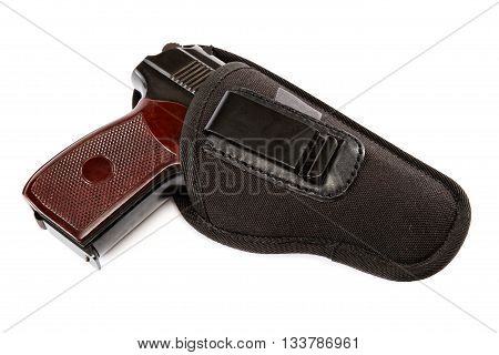 Gun in a holster isolated on white background.