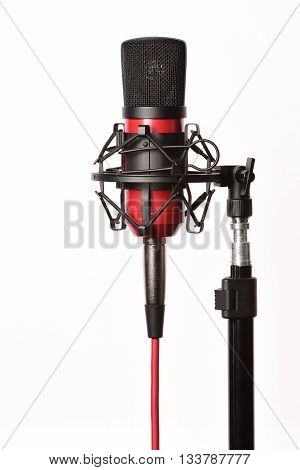 Professional studio condenser microphone with cord, isolated on white background