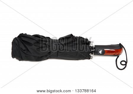 Modern black umbrella isolated on white background.