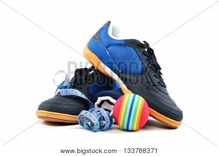 Sport shoes equipment and measuring tape on a white background.