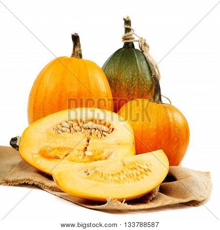 Pumpkins on sackcloth isolated over white background.