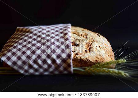 Tilt Shift artisan bread with ears of wheat