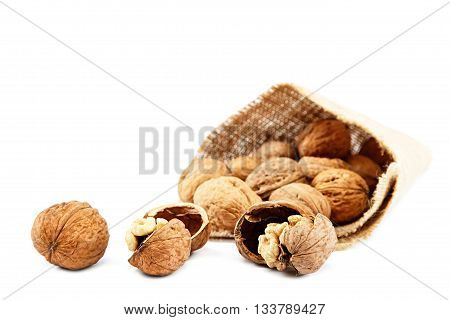 Walnut in a bag isolated on a white background.