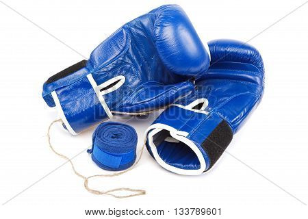 Blue boxing gloves and bandages isolated on a white background.