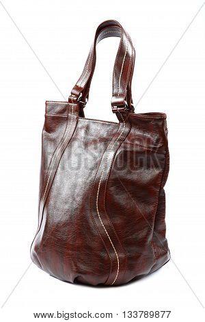 Modern fashionable leather female bag isolated on white background.