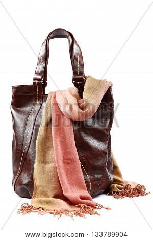 Modern fashionable female bag and scarf with tassels isolated on white background.