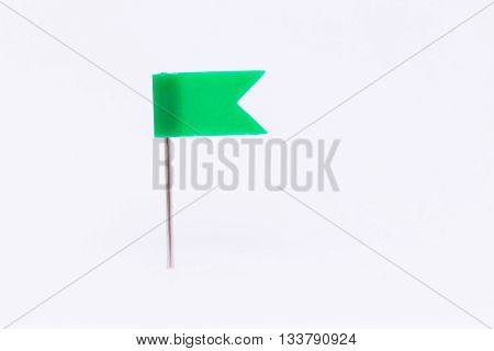 Green flag pin isolated white background.Green flag pin